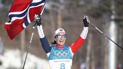 Norway's Marit Bjoergen celebrates after winning the women's 30km cross country mass start.