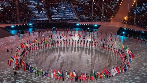 Flagbearers arrive during the closing ceremony.