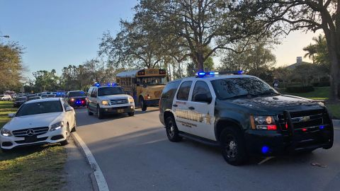"""Sheriff vehicles are seen at Marjory Stoneman Douglas High School in Parkland, Florida, a city about 50 miles (80 kilometers) north of Miami on February 14, 2018 following a school shooting. A gunman opened fire at the Florida high school, an incident that officials said caused """"numerous fatalities"""" and left terrified students huddled in their classrooms, texting friends and family for help. The Broward County Sheriff's Office said a suspect was in custody. / AFP PHOTO / Michele Eve SANDBERG        (Photo credit should read MICHELE EVE SANDBERG/AFP/Getty Images)"""