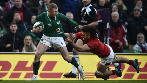 Keith Earls tries to escape the clutches of Welsh flanker Josh Navidi.