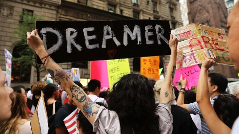 Dozens of immigration advocates and supporters attend a rally outside of  Trump Tower along Fifth Avenue on August 15, 2017 in New York City.  Photo by Spencer Platt/Getty Images