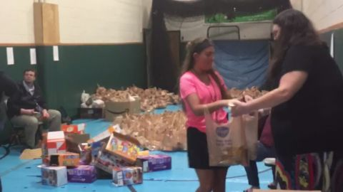 Students and teachers packing lunches at Horace Mann Middle School in Charleston, West Virginia.