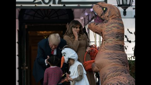 "The Trumps hand out candy to children during a White House <a href=""https://www.cnn.com/videos/politics/2017/10/31/trump-white-house-halloween-erin-moos-pkg.cnn"" target=""_blank"">Halloween event.</a>"