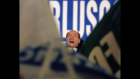 Berlusconi smiles during a rally in Rome on May 11, 2001. Two days later, he won the general election.