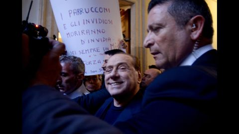 Berlusconi smiles as he arrives at his home in Rome in March 2015. Italy's top court had just cleared him of charges that he paid for sex with an underage dancer and then abused his position as prime minister to cover it up.