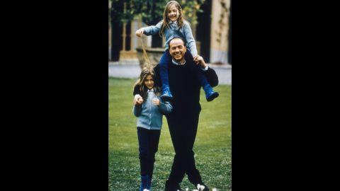 Berlusconi plays with daughters Barbara, left, and Eleonora in Milan.