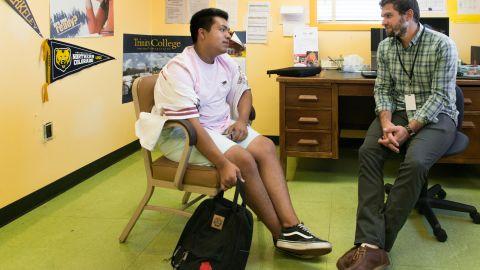 Gerardo Alejandrez with counselor Erich Roberts at Oakland Technical High School.