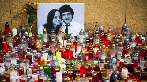 Hundreds of candles were placed in front of a portrait of Slovak investigative journalist Jan Kuciak and his fiancée, Martina Kušnírová, in the center of Bratislava on February 27.