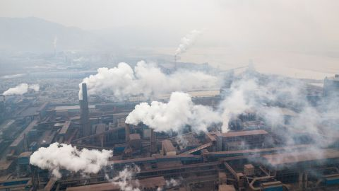 Aerial view of pollution being emitted from steel factories in Hancheng, Shaanxi, China