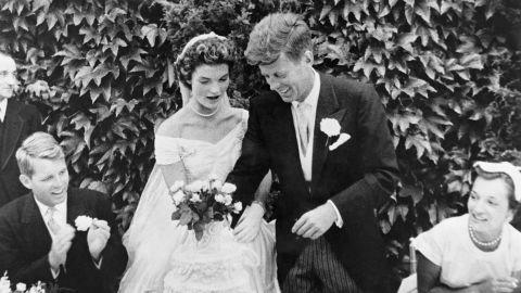 (Original Caption) John F. Kennedy and Jacqueline Bouvier cutting their wedding cake after their marriage in Newport, Rhode Island. John Kennedy was then U.S. Senator from Massachusetts. Robert Kennedy at left.