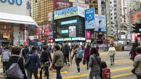 People go about their daily routines in Causeway Bay, Hong Kong.