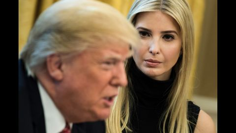 TOPSHOT - Ivanka Trump listens while her father US President Donald Trump speaks via video with NASA astronauts aboard the International Space Station from the Oval Office of the White House April 24, 2017 in Washington, DC. / AFP PHOTO / Brendan Smialowski        (Photo credit should read BRENDAN SMIALOWSKI/AFP/Getty Images)
