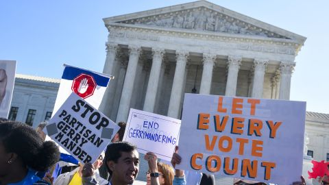 """People hold signs during a rally to call for """"An End to Partisan Gerrymandering"""" at the Supreme Court of the United States on October 3, 2017 in Washington, DC."""