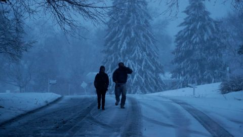 A family heads down a snowy street in Marple Township, Pennsylvania, on March 2.