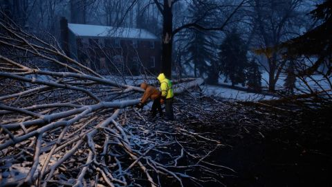 Workers David Boardly, left, and James Ockimey clear a downed tree in Marple Township, Pennsylvania, on March 2.