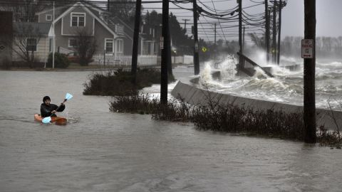 Daniel Cunningham, 22, dodges waves in a kayak in Quincy on March 2.