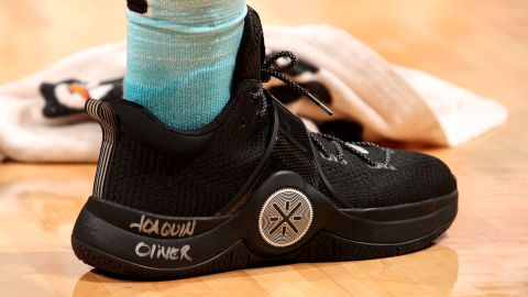 Dwyane Wade wrote the slain student's name on his game shoes Saturday.