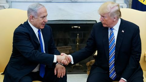 """US President Donald Trump shakes hands with Israel's Prime Minister Benjamin Netanyahu in the Oval Office of the White House on  March 5, 2018 in Washington, DC. President Donald Trump said he """"may"""" attend the opening of a controversial new US embassy in Jerusalem, a fraught prospect designed to underscore close ties with Benjamin Netanyahu, whom he hosted Monday.Trump warmly welcomed the embattled prime minister to the White House, claiming US-Israel ties had """"never been better"""" and floating a May trip that would be a major security and diplomatic challenge.  / AFP PHOTO / MANDEL NGAN        (Photo credit should read MANDEL NGAN/AFP/Getty Images)"""