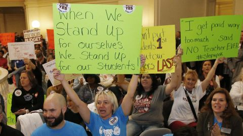 In this Feb. 12, 2018 photo, Edmond school counselor Wendy Joseph, left, cheers with other supporters of the teacher pay raise during a rally at the state Capitol in Oklahoma City.