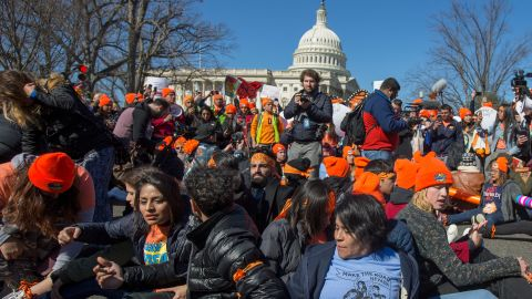 WASHINGTON, DC - MARCH 05:  Pro DACA and Dreamer supporters chain themselves to each other outside the US Capital on March 5, 2018 in Washington, DC.  (Photo by Tasos Katopodis/Getty Images for MoveOn.org)