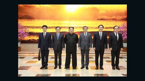 PYONGYANG, NORTH KOREA - MARCH 05: In this handout image provided by the South Korean Presidential Blue House, Chung Eui-Yong (2nd L), head of the presidential National Security Office pose with North Korean leader Kim Jong-Un (3rd L) on March 5, 2018 in Pyongyang, North Korea. South Korean envoys are to visit North Korea for two days to discuss issues. (Photo by South Korean Presidential Blue House via Getty Images)