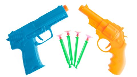 Plastic toy gun with darts isolated on white background; Shutterstock ID 631857956; Job: -