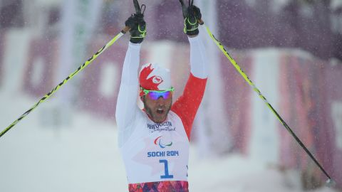 Canadian cross-country skier Brian McKeever takes gold in the 1km sprint, visually impaired, in Sochi.