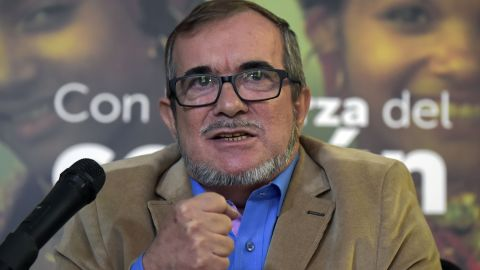 """Rodrigo Londono Echeverri, known as """"Timochenko"""", the presidential candidate for the Common Alternative Revolutionary Force (FARC) party, speaks during a press conference in Bogota, on February 28, 2018. Londono delivered an S.O.S. message to save the pact of peace in the country, after he had to suspend his campaigns for political office, citing a lack of security safeguards. / AFP PHOTO / Raul ARBOLEDA        (Photo credit should read RAUL ARBOLEDA/AFP/Getty Images)"""
