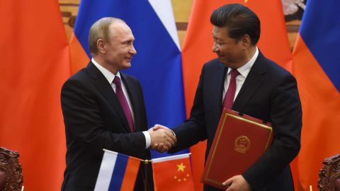 Russian President Vladimir Putin (L) shakes hands with Chinese President Xi Jinping during a signing ceremony in Beijing's Great Hall of the People on June 25, 2016 in Beijing, China.