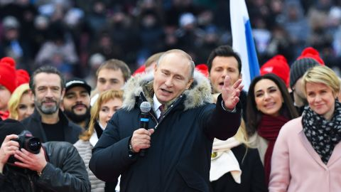 TOPSHOT - Presidential candidate, President Vladimir Putin gives a speech during a rally to support his candidature in the upcoming presidential election at the Luzhniki stadium in Moscow on March 3, 2018. Russians will go to the polls on March 18, 2018. / AFP PHOTO / Kirill KUDRYAVTSEV        (Photo credit should read KIRILL KUDRYAVTSEV/AFP/Getty Images)