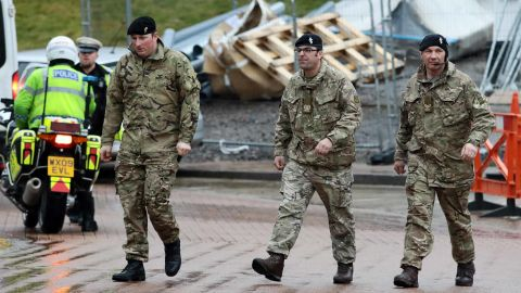 Military personnel are seen outside Salisbury District Hospital, Sunday.