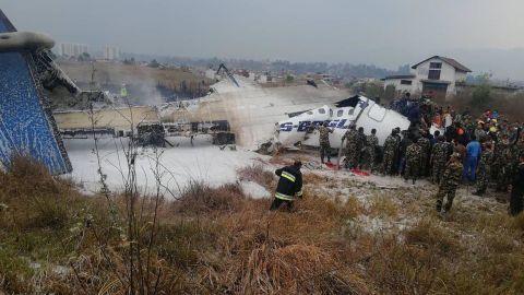 Emergency teams work around the wreckage.