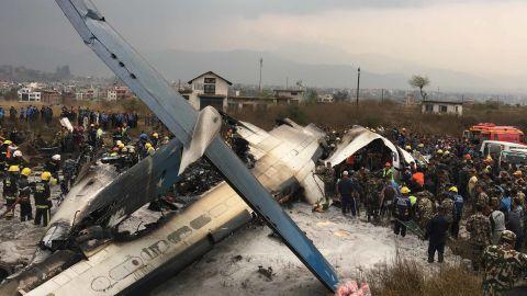 Rescuers survey the crash site.