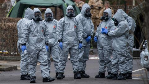 SALISBURY, ENGLAND - MARCH 11:  Military personnel wearing protective suits remove a police car and other vehicles from a public car park as they continue investigations into the poisoning of Sergei Skripal on March 11, 2018 in Salisbury, England. Sergei Skripal who was granted refuge in the UK following a 'spy swap' between the US and Russia in 2010 and his daughter remain critically ill after being attacked with a nerve agent.  (Photo by Chris J Ratcliffe/Getty Images)