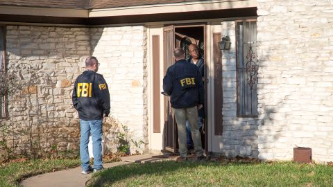 Authorities are investigating the scene in East Austin, Texas, after a teenager was killed and a woman was injured in the second Austin package explosion in the past two weeks Monday, March 12, 2018. Authorities say a package that exploded inside of an Austin home on Monday is believed to be linked to a deadly package sent to another home in Texas' capital city earlier this month. (Ricardo B. Brazziell/Austin American-Statesman via AP)