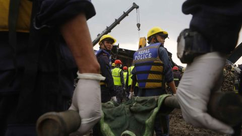 Rescuers work to recover victims on March 12. Officials said 40 bodies were recovered at the scene and nine died at the hospital. Twenty-two survivors were receiving treatment.