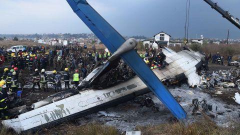 Emergency crews work around the crash site.