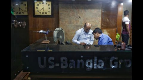 Staff from US-Bangla Airlines, a privately owned Bangladeshi carrier, work at an office in Dhaka, Bangladesh, on March 12. Flight BS 211 belongs to US-Bangla.
