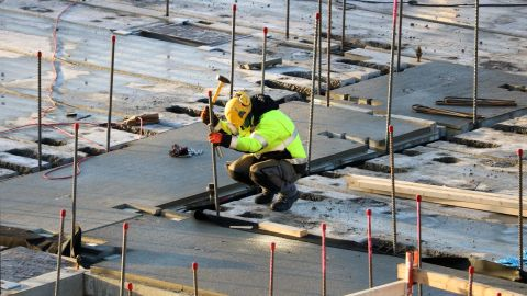 A construction worker can be seen working on a construction site.