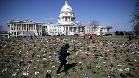 WASHINGTON, DC - MARCH 13:  Seven thousand pairs of shoes, representing the children killed by gun violence since the mass shooting at Sandy Hook Elementary School in 2012, are spread out on the lawn on the east side of the U.S. Capitol March 13, 2018 in Washington, DC. Organized by the online activist group Avaaz, the shoes are intended to urge Congress to pass gun-reform legislation.   (Photo by Chip Somodevilla/Getty Images)