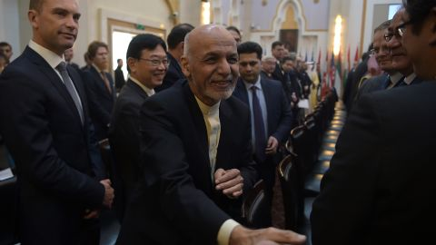 Afghan President Ashraf Ghani greets delegates at the Presidential Palace in Kabul in February.