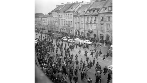** TO GO WITH STORY BC POLAND JEWISH PURGE BY RYAN LUCAS ** FILE ** A March 1968 black and white file photo showing people running away as police attack near the Warsaw University during student riots. The 1968 student riots in Poland ended with an anti-Semitic campaign by the communist regime that drove an estimated 15,000 Jews from Poland. (AP Photo/PAP/CAF-Tadeusz Zagozdzinski, file)