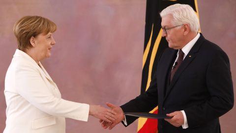 Chancellor Angela Merkel with German President Frank-Walter Steinmeier Wednesday