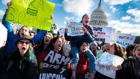 """Students participate in a rally with other students from DC, Maryland and Virginia in their Solidarity Walk-Out to urge Republican leaders in Congress """"to allow votes on gun violence prevention legislation."""" on Capitol Hill in Washington, DC, March 14, 2018. Students across the US walked out of classes on March 14, in a nationwide call for action against gun violence following the shooting deaths last month at a Florida high school. The nationwide protest is being held one month to the day after Nikolas Cruz, a troubled 19-year-old former student at Stoneman Douglas, unleashed a hail of gunfire on his former classmates. / AFP PHOTO / JIM WATSON        (Photo credit should read JIM WATSON/AFP/Getty Images)"""