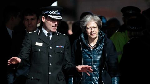 Police official Kier Pritchard and British Prime Minister Theresa May view the crime scene in Salisbury.
