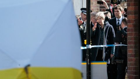 UK Prime Minister Theresa May visits the scene on March 15 where Sergei Skripal and his daughter Yulia were discovered in Salisbury.