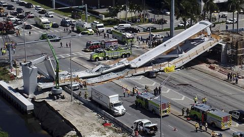"""Emergency personnel respond to a <a href=""""https://www.cnn.com/2018/03/16/us/bridge-collapse-florida/index.html"""" target=""""_blank"""">deadly bridge collapse in Miami</a> on Thursday, March 15. The bridge was installed Saturday at Florida International University."""