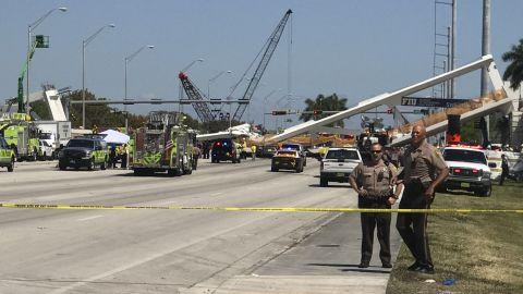 Police block a road near the collapsed bridge.