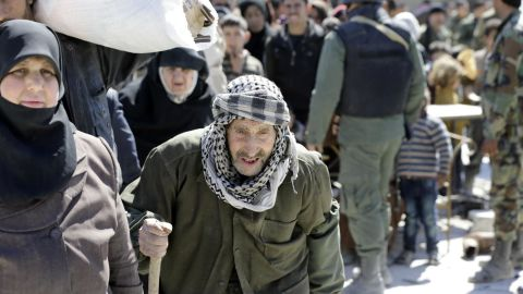 Syrian civilians evacuated from Eastern Ghouta wait to be relocated to other areas.