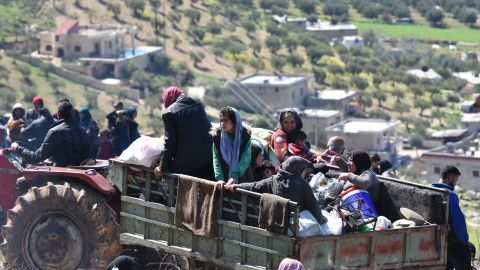 Civilians flee the city of Afrin in northern Syria on March 16, 2018.